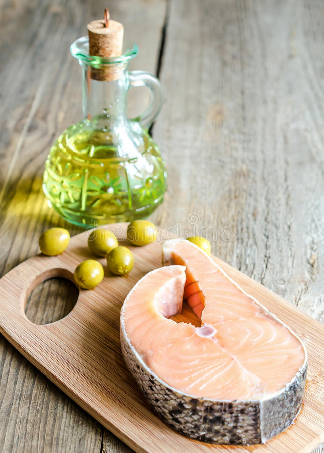 Food with unsaturated fats - salmon and olive oil. Food with healthy fats - salmon and oil stock images