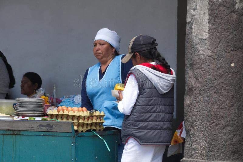 Food vendor in Cotacachi. Indigenous woman selling food on Day of the Dead in Cotacachi, Ecuador stock image