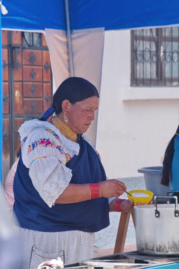 Food vendor in Cotacachi. Indigenous woman selling food on Day of the Dead in Cotacachi, Ecuador royalty free stock photography