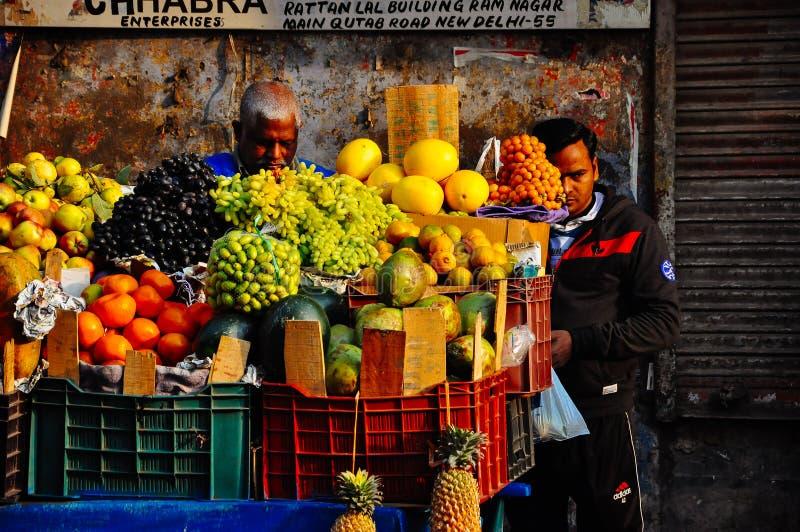 A food vendor sells his fruit in Delhi, India. A food vendor sells his fruit in Old Delhi, India stock photo