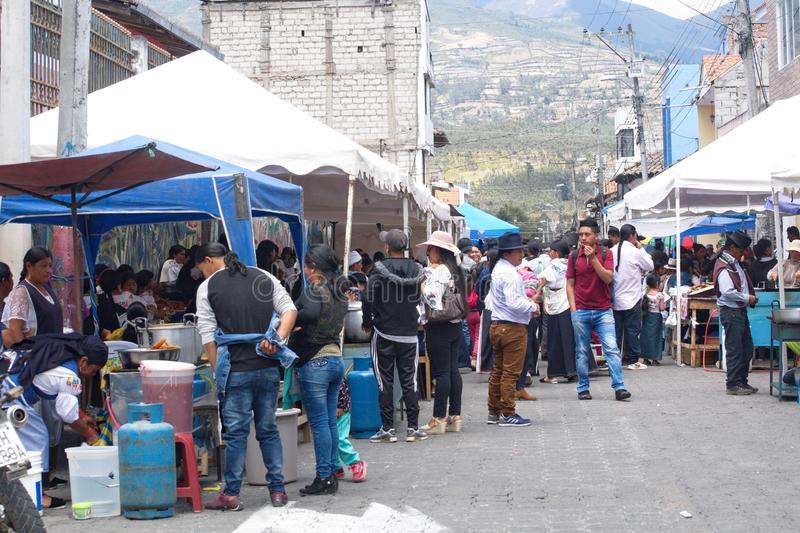 Food vendors in Cotacachi. Crowd in a food court area on Day of the Dead in Cotacachi, Ecuador stock photography