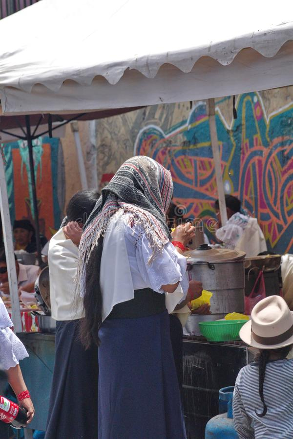 Food vendors in Cotacachi. Crowd in a food court area on Day of the Dead in Cotacachi, Ecuador royalty free stock image