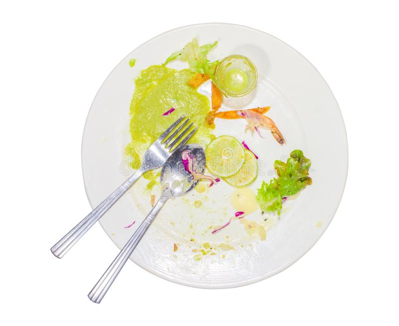 Food waste, after eating steak, fish sauce, chili, lime, purple cabbage, shrimp and dirty spoon in the dish. Isolated white backgr stock images