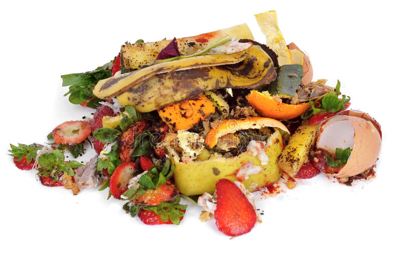 Food waste. A pile of food waste, such as eggshells and fruit and vegetable peels, on a white background stock image