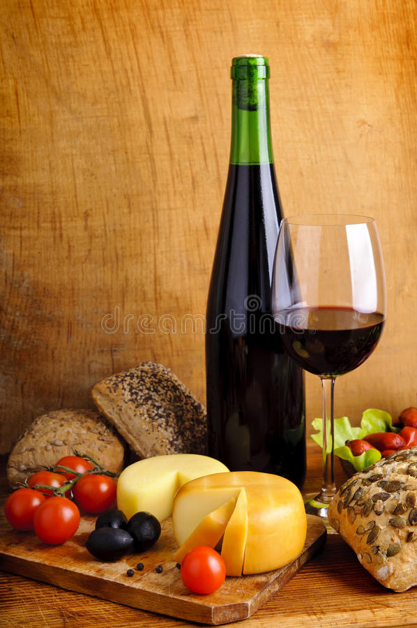 Food and wine. Still life with traditional food and red wine royalty free stock images