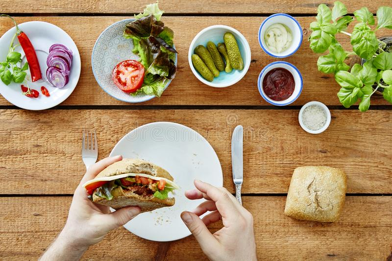 Foodie eating self made delicious sandwich snack. Blogger homemade royalty free stock image