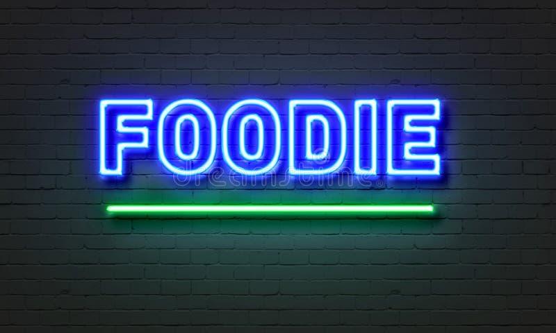 Foodie-Leuchtreklame auf Backsteinmauerhintergrund lizenzfreies stockbild