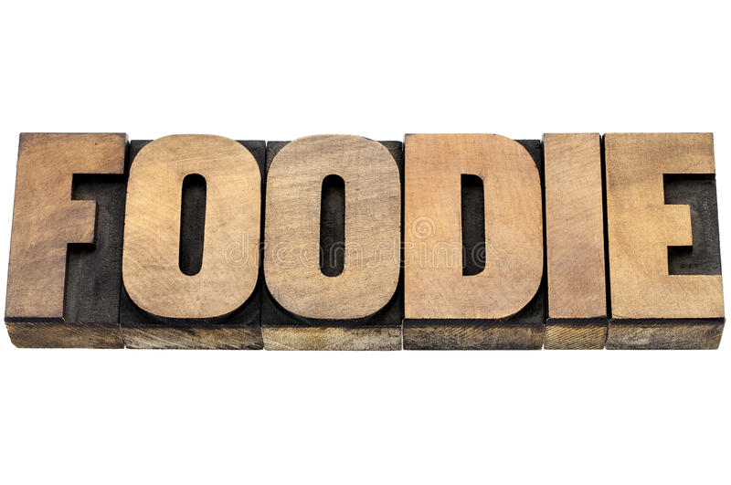 Foodie word in wood type. Foodie word - isolated text in letterpress wood type stock image