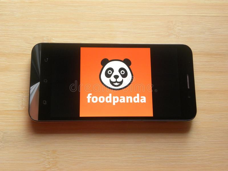 Foodpanda app. On smartphone kept on wooden table stock images