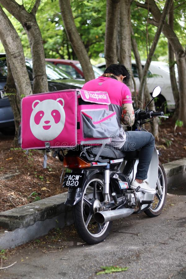 Foodpanda Rider Stop By The Road royalty free stock photography