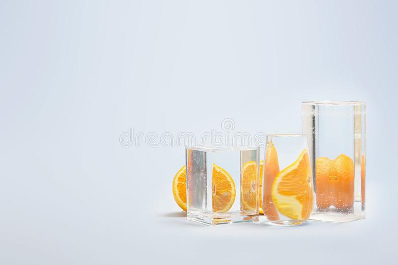 Foods distorted through liquid and glass on blue background. Perspective, fractured and skewed images of common foods as seen through vessels filled with water stock photo
