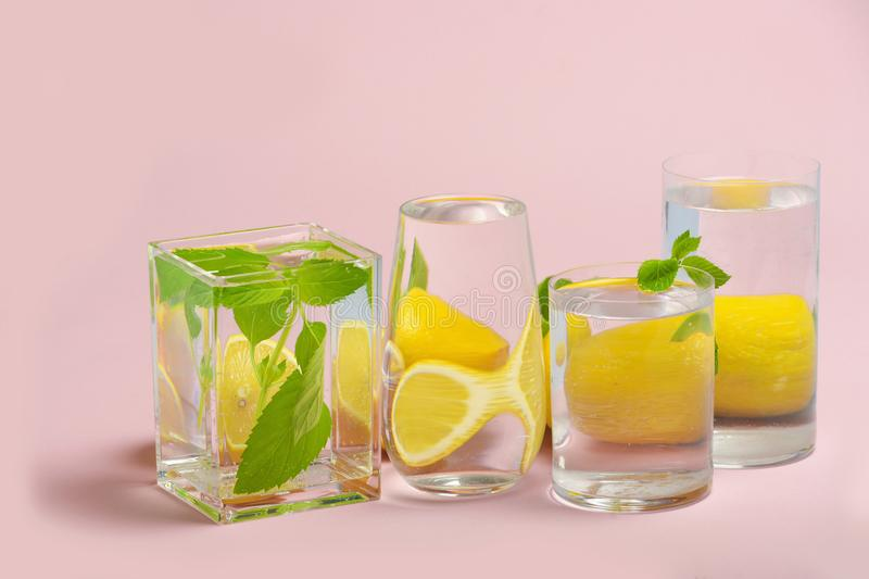 Foods distorted through liquid and glass on pink background. Perspective, fractured and skewed images of common foods as seen through vessels filled with water stock image