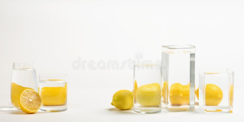Foods distorted through liquid and glass on white background. Perspective, fractured and skewed images of common foods as seen through vessels filled with water royalty free stock images