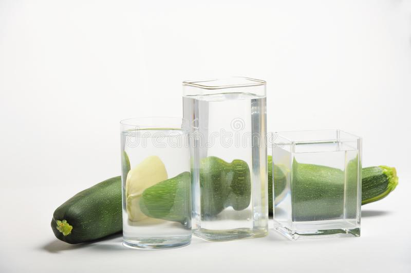 Foods distorted through liquid and glass on white background. Perspective, fractured and skewed images of common foods as seen through vessels filled with water stock images