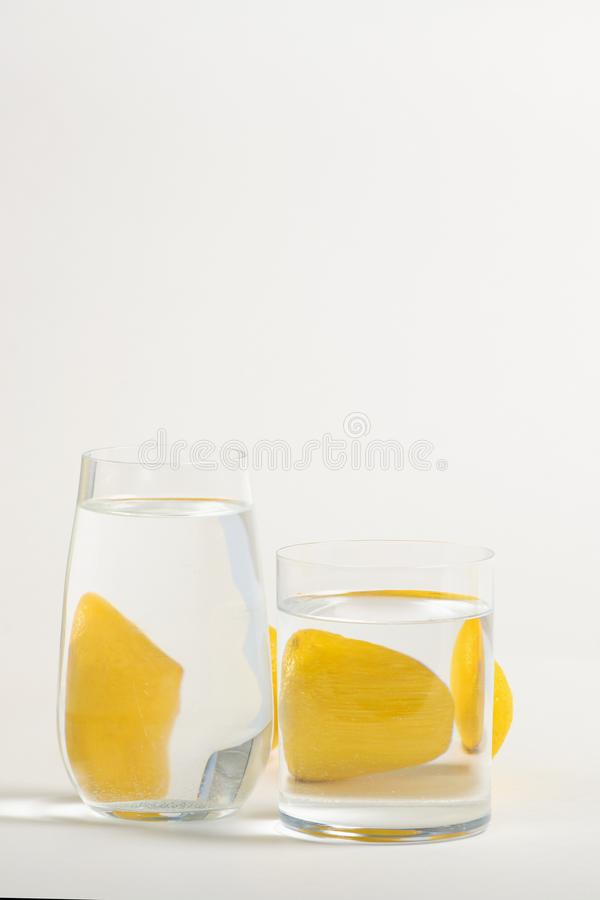 Foods distorted through liquid and glass on white background. Perspective, fractured and skewed images of common foods as seen through vessels filled with water stock photos