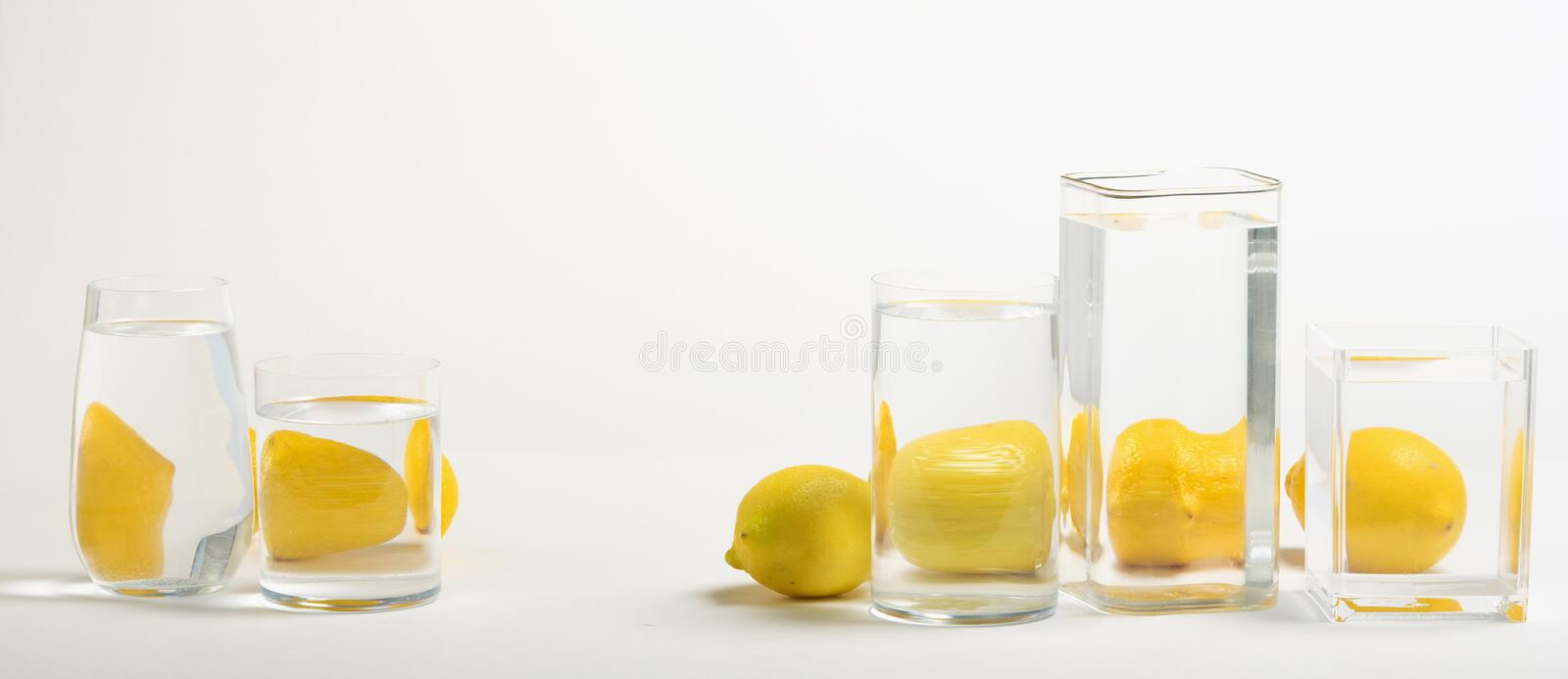 Foods distorted through liquid and glass on white background. Perspective, fractured and skewed images of common foods as seen through vessels filled with water royalty free stock photos