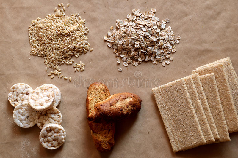Foods high in carbohydrate. Healthy eating, diet concept. Bread, rice cakes, brown rice, oats. Oats and rice. Rice cakes and bread in background. Foods high in royalty free stock photography