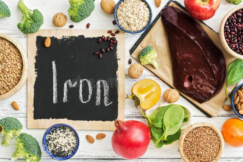 Foods high in iron, fruits, vegetables, liver on a white wooden table. Top view, flat lay. The concept of health food and macroele royalty free stock images