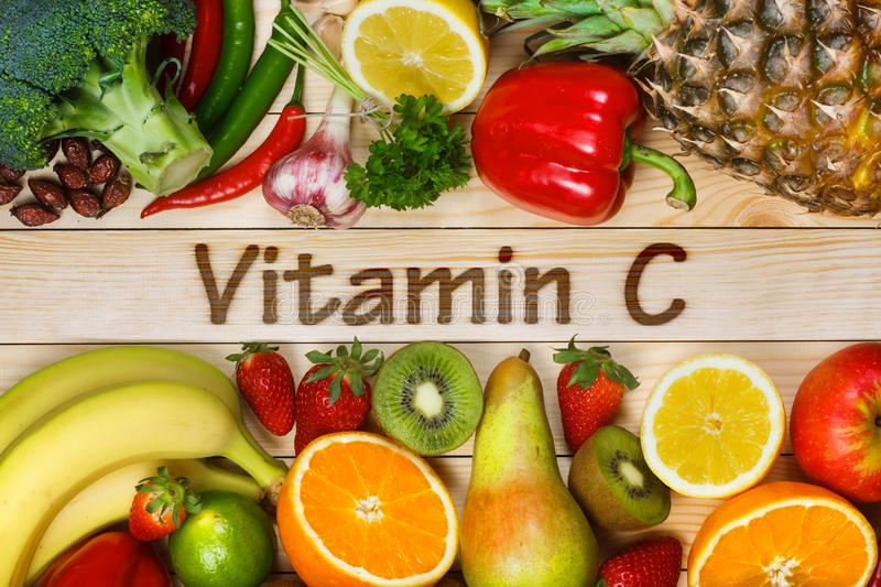Foods High in Vitamin C. Vitamin C in fruits and vegetables. Natural products rich in vitamin C as oranges, lemons, dried fruits rose, red pepper, kiwi, parsley stock photos