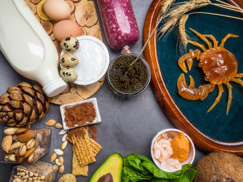 Foods High in Zinc as fish, shrimps, beef, cheese, spinach, cocoa, pumpkin seeds, crab, black caviar, coconut, milk, cheese, eggs. Foods High in Zinc as fish royalty free stock images