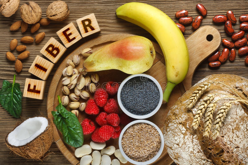 Foods rich in fiber. As rye bread, wheat bran, white beans, red beans, spinach, almonds, poppy seed, pears, bananas, coconut, raspberries, pistachios, walnuts stock photography