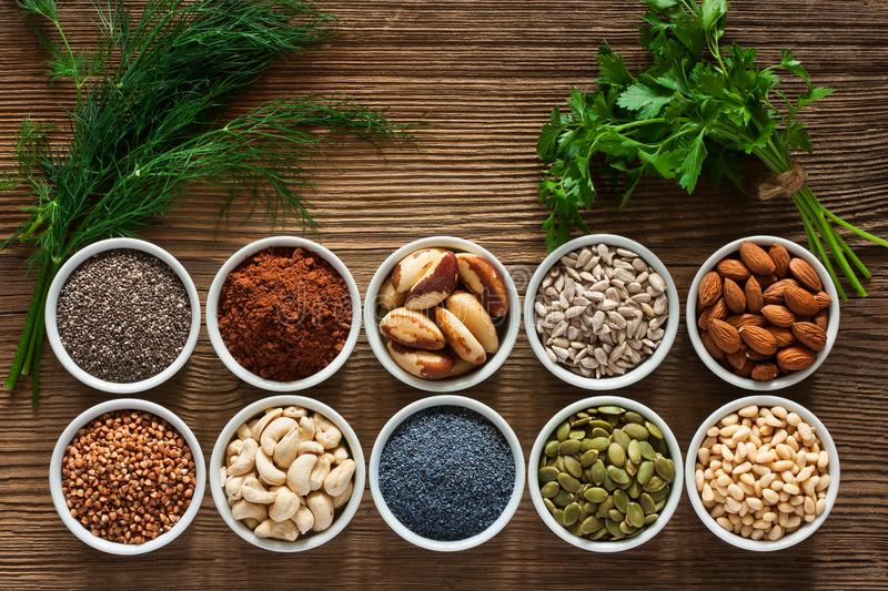 Foods rich in magnesium. As pumpkin seeds, blue poppy seed, cashew nuts, almonds, sunflower seeds, buckwheat, cocoa, chia, pine nuts, brazil nuts, parsley stock photos