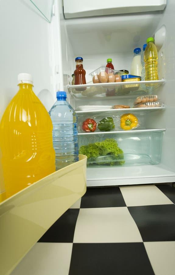 Foodstuffs in fridge. royalty free stock photos