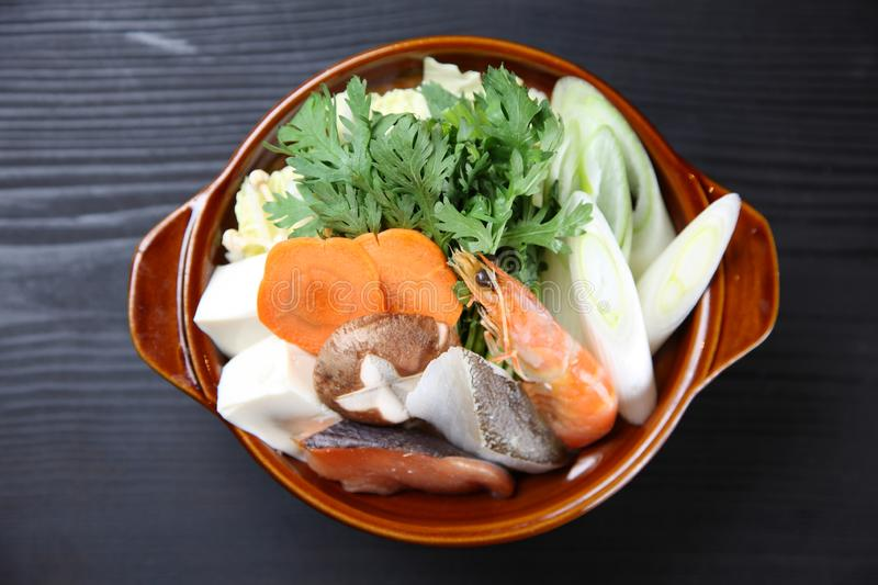 Foodstuffs of Seafood Sumo Wrestler Hot Pot. Close Up Shot Of Foodstuffs of Seafood Sumo Wrestler Hot Pot on a dining table royalty free stock photos