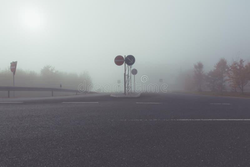 foogy sunrise at highway stock photo