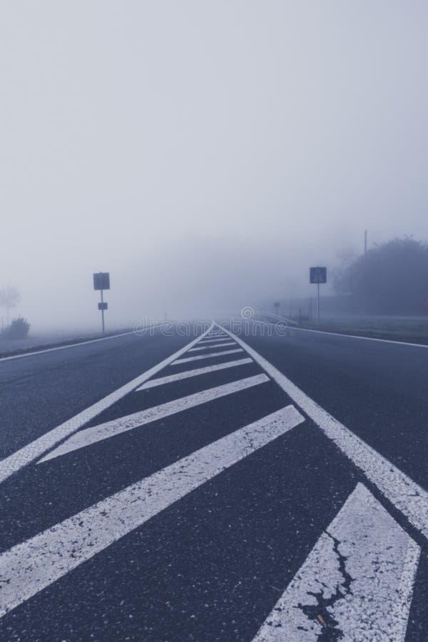 foogy sunrise at highway stock photography