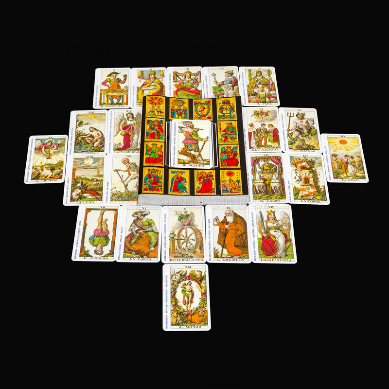 The fool card. The book of the Tarot and all 22 Major Arcana,with foreground The Fool card royalty free stock photos