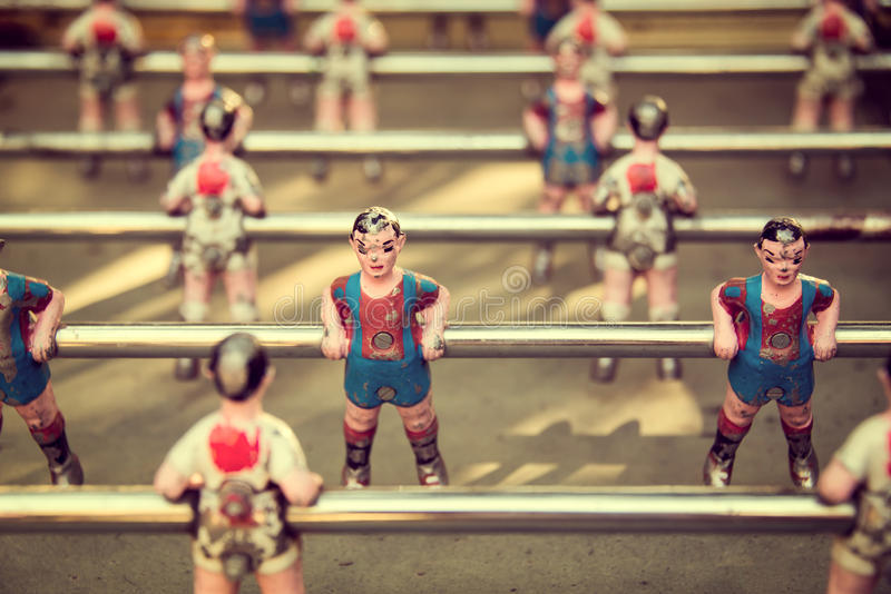 Foosball, old used table football. Vintage style royalty free stock photography