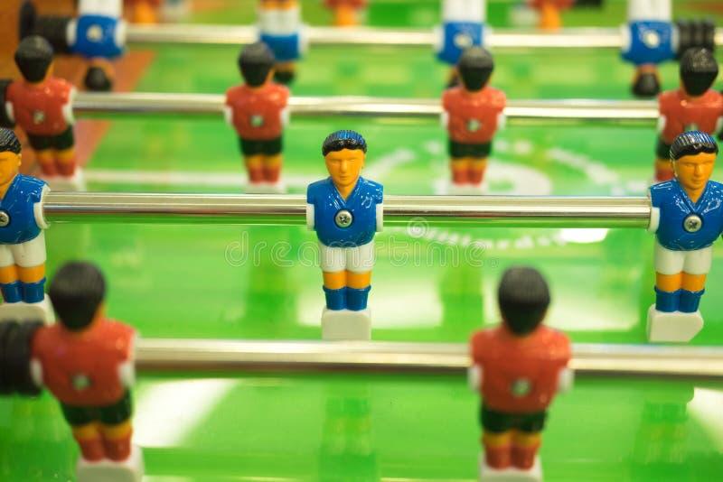 Foosball-Tabellen-Fußballspiel lizenzfreie stockfotos