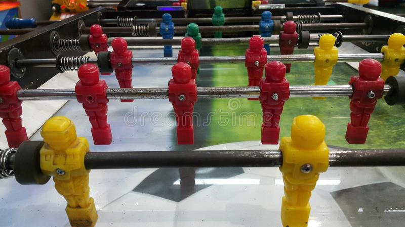 Foosball table in games center. Foosball table center games indoors activity relax sports view lifestyle area  local stock photo