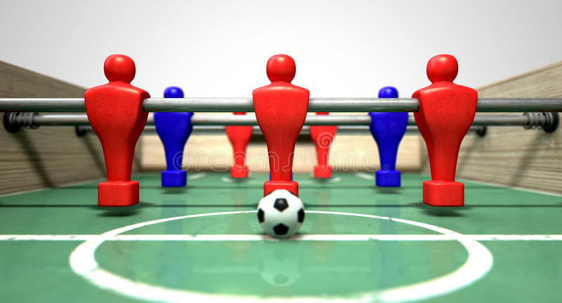 Foosball Table. At ground level with a soccer ball in front of the red team ready to kick off a soccer match stock photo