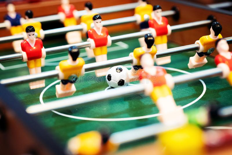 Foosball table soccer. football player, sport concept stock images