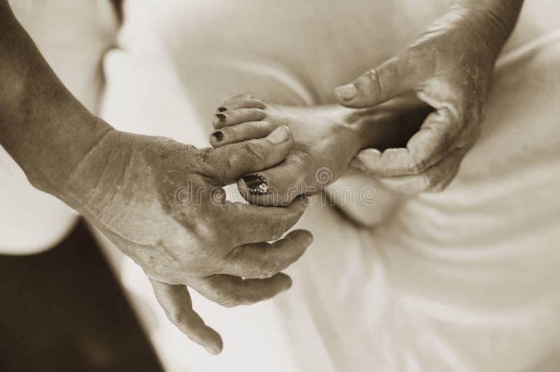 Foot Acupressure + Massage royalty free stock photo