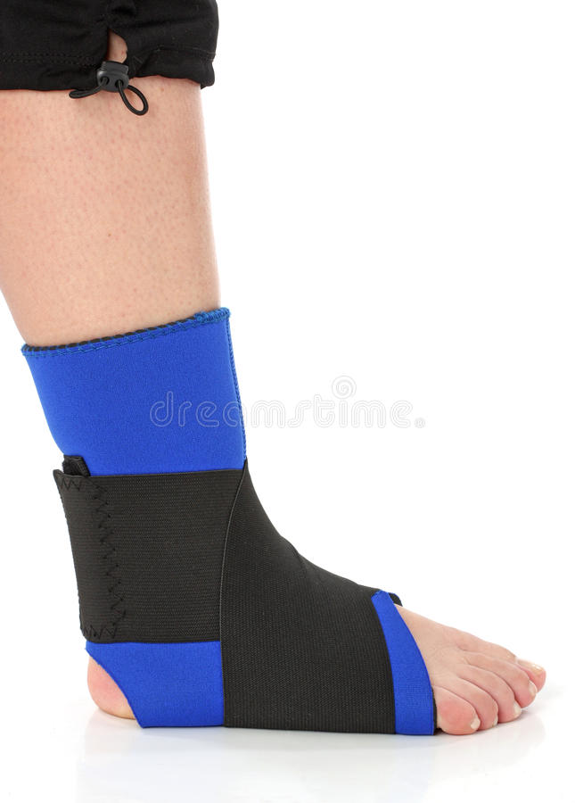 Foot with an ankle brace stock images