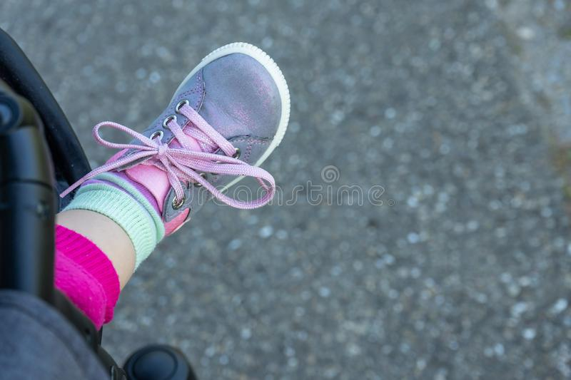 Foot of a baby with shoe royalty free stock photos