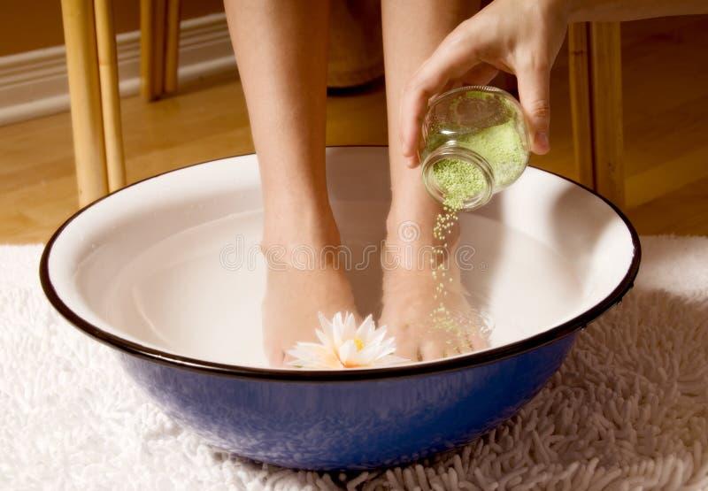 Foot bath. Woman in foot bowl at a spa