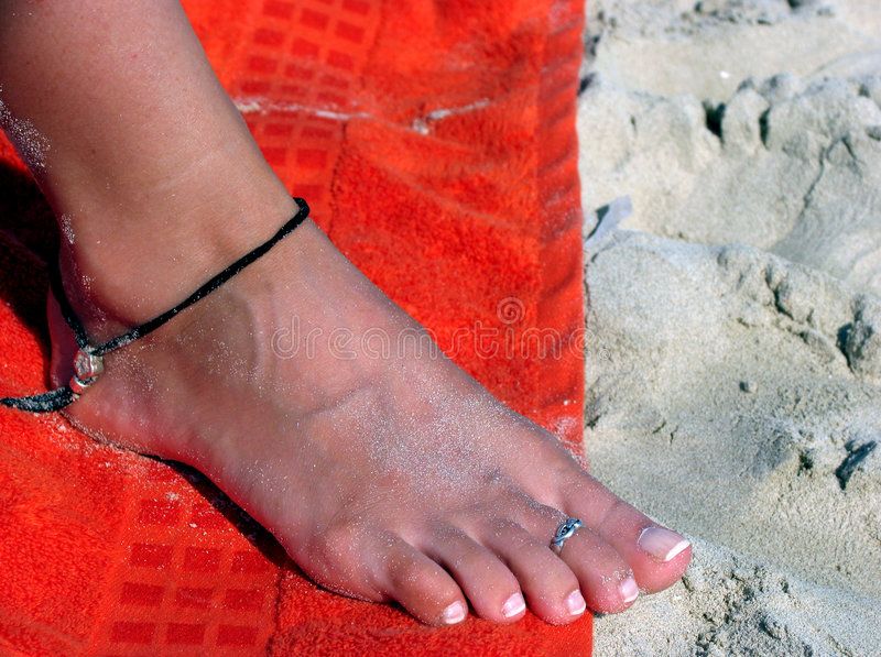 Foot on the beach royalty free stock images