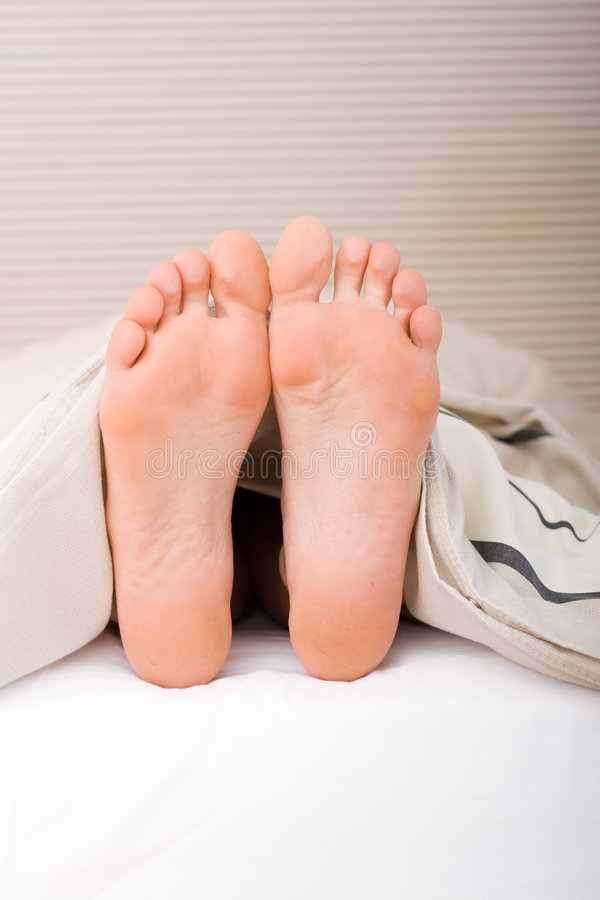 Foot On Bed Stock Image