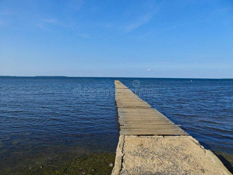 a foot bridge to the sea royalty free stock photo