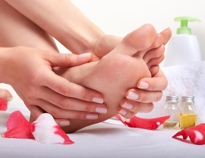 Foot care and massage stock photos