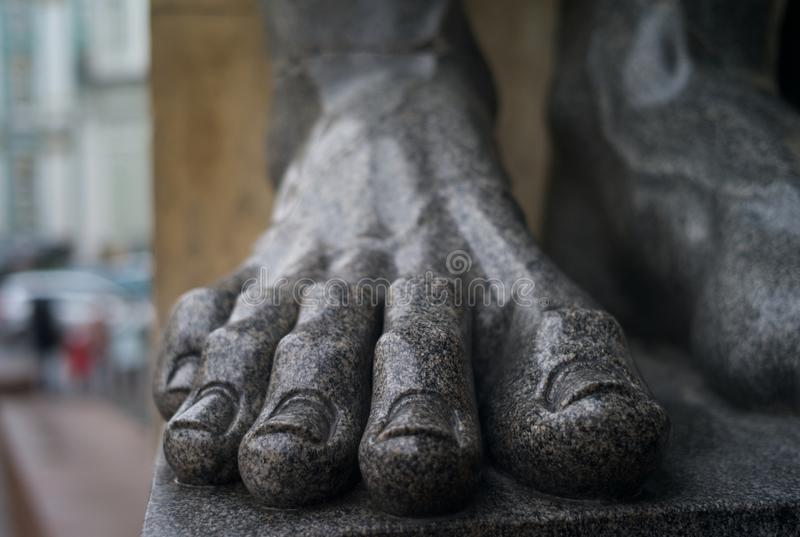 Foot of a Colossal Statue. A detail of a colossal statue. A part of the facade of the Eremitage in Saint Petersburg, Russia stock photos