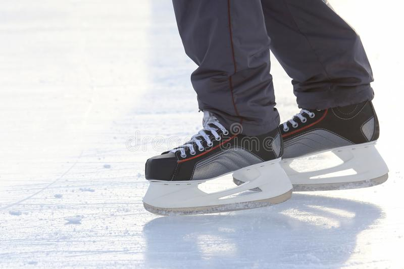 Foot ice-skating person on the ice rink. The foot ice-skating person on the ice rink royalty free stock image