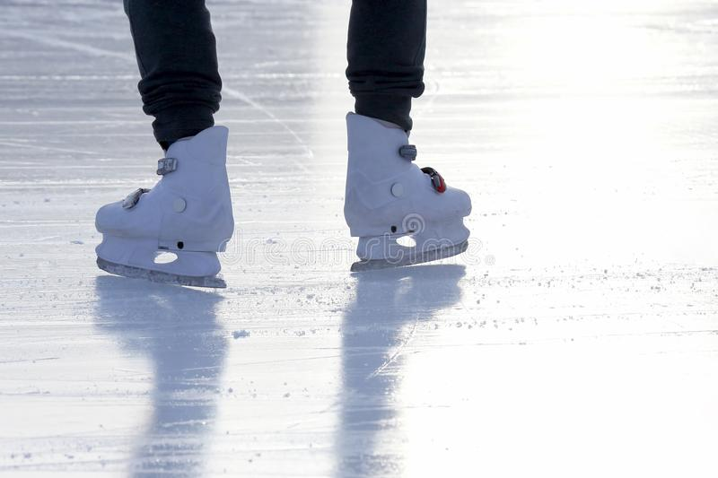 Foot ice-skating person on the ice rink. The foot ice-skating person on the ice rink stock image