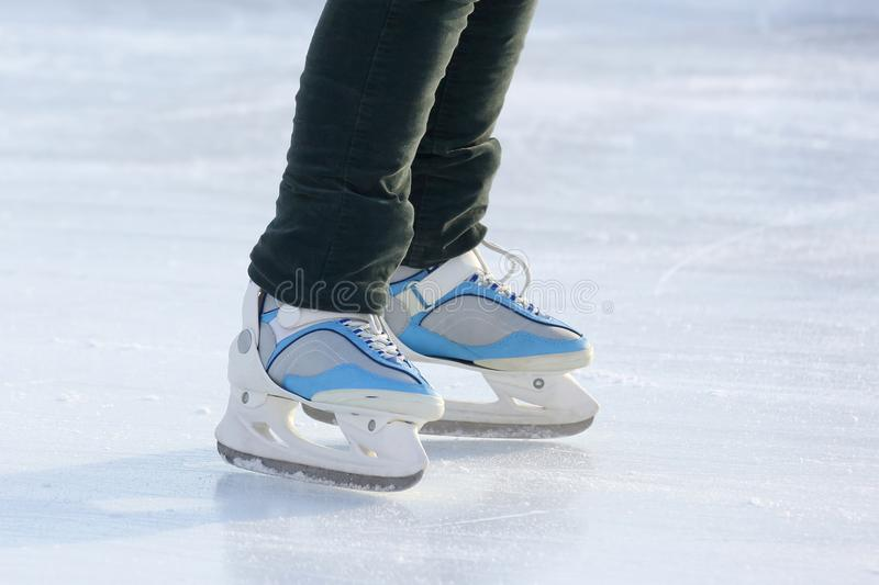 Foot ice-skating person on the ice rink. The foot ice-skating person on the ice rink stock photo
