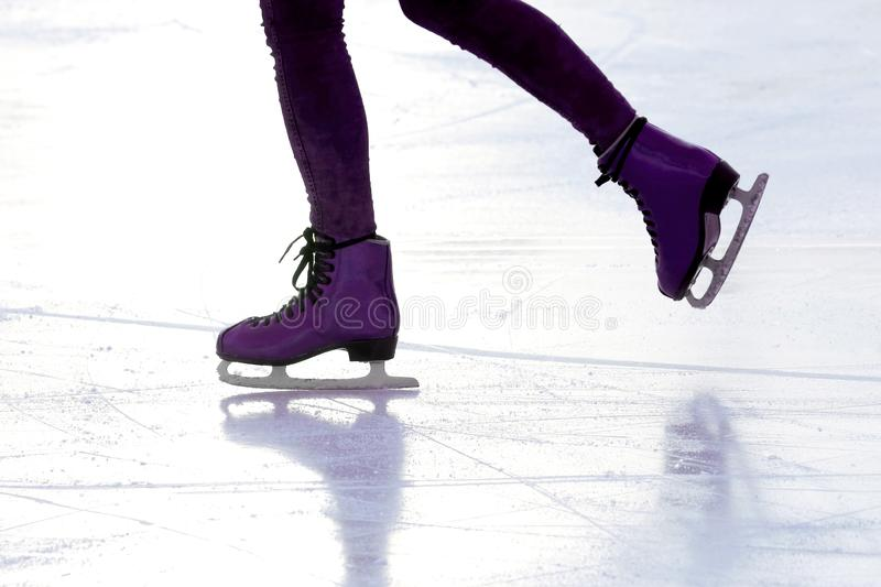 Foot ice-skating person on the rink in the sunlight. The foot ice-skating person on the rink in the sunlight. vacation sports and hobbies royalty free stock images