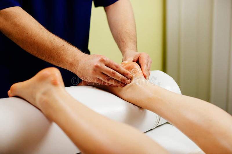 Foot masage relaxation stock images